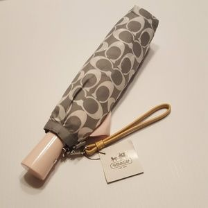 New with tags coach signature umbrella. Gray/Pink